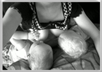 Read about twin positioning for breastfeeding
