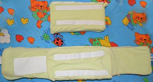 Velcro strips on back support pillow and back panel