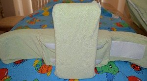Back support pillow attached to the back panel vertically